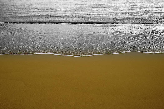 Waves on the seashore on the golden sand by Vicen Photography