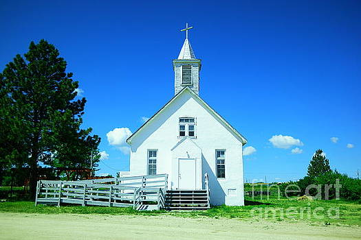 White wooden church  by Jeff Swan