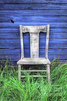 Wooden Chair against the Blue Wall by Jill Battaglia