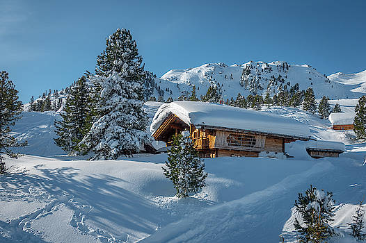 Wooden House Covered With Snow by Karsten Eggert