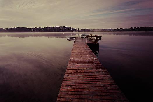 Wooden jetty on the lake at night, long exposure shot by Lukasz Szczepanski