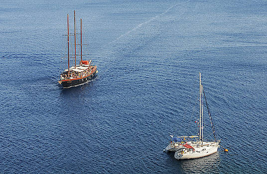 Yachts sailing on a blue calm sea by Michalakis Ppalis