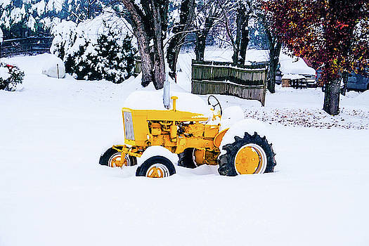 Yellow Tractor in the snow by Seth Solesbee