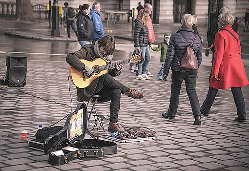 Young Guitarist street musician  by Michalakis Ppalis