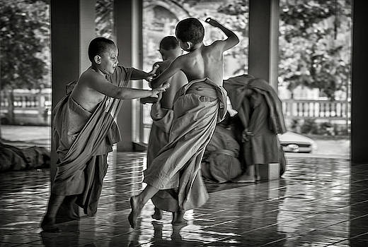 Young Novice Monks Play by Lee Craker
