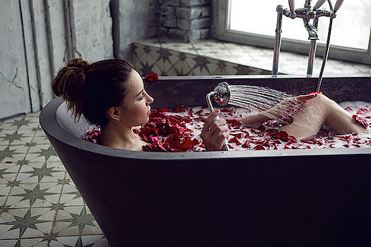 Young Sexy Beautiful Woman Lies In A Stone Bath With Petals by Elena Saulich