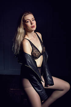 Young Sexy Girl Sitting On Chair In Lingerie by Elena Saulich