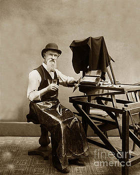 California Views Archives Mr Pat Hathaway Archives - C.W.J. Johnson at his glass negative retouching stand  holding a