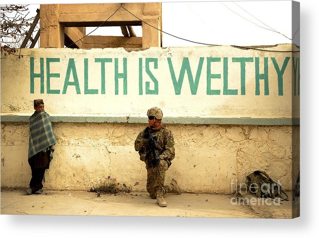 Village Acrylic Print featuring the photograph A Soldier Talks To An Afghan Boy by Stocktrek Images