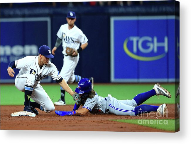 People Acrylic Print featuring the photograph Toronto Blue Jays V Tampa Bay Rays by Mike Ehrmann