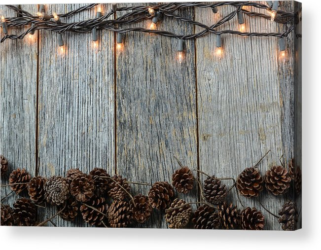 Tree Acrylic Print Featuring The Photograph Christmas Lights And Pinecones On Rustic Wood Background By Brandon