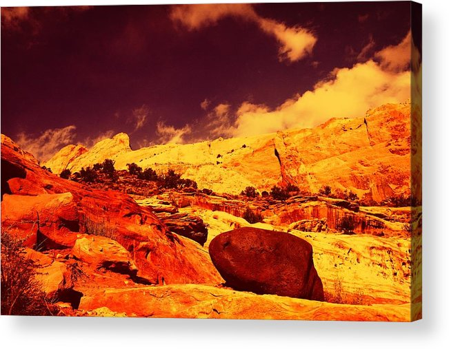 Acrylic Print featuring the photograph A Black Rock And Blue Sky by Jeff Swan