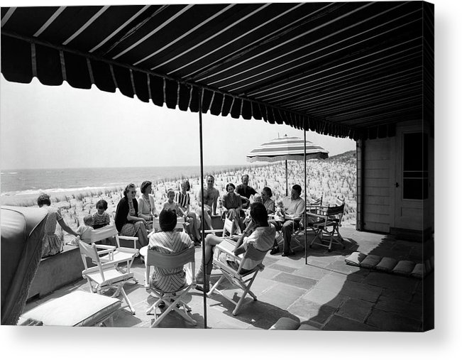 Home Accessories Acrylic Print featuring the photograph A Group Of People On A Terrace Overlooking by Tom Leonard