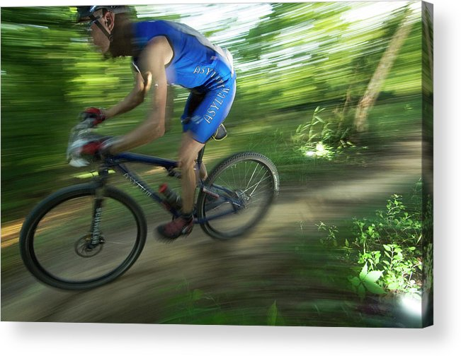 Action Acrylic Print featuring the photograph A Mountain Biker Races On A Trail by Andrew Kornylak