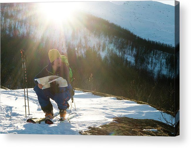 20s Acrylic Print featuring the photograph A Norwegian Skier Examines A Map by Kari Medig