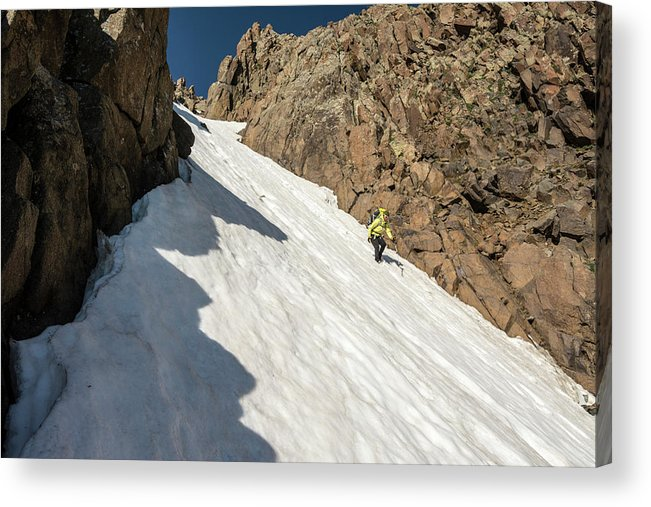 Low Angle View Acrylic Print featuring the photograph A Woman Descending A Snow Slope While by Kennan Harvey