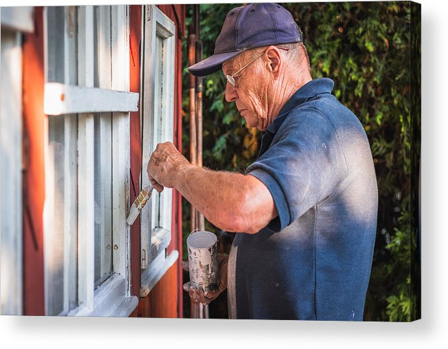 Active Senior Man Painting Window Frame Of Wooden Cabin  House Improvemnet   Acrylic Print