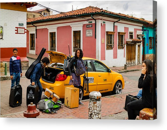 Bogotá, Colombia - A Group Of Local Musicians Seen Moving Their Equipment  Using A Taxi Just Of Chorro De Quevedo In The Historic La Candelaria