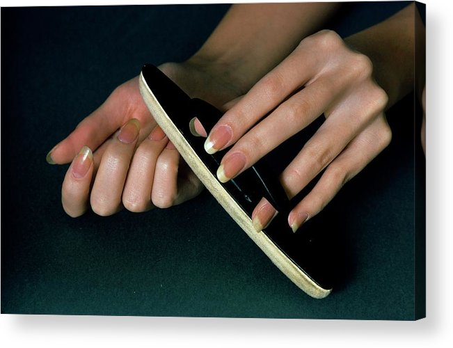 Hands Of A Model Using A Nail Buffer Acrylic Print by William Connors