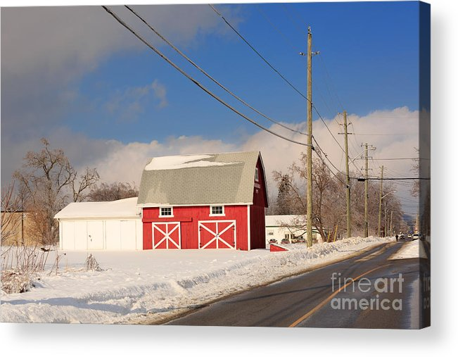 Red Acrylic Print featuring the photograph Historic Red Barn On A Snowy Winter Day by Louise Heusinkveld