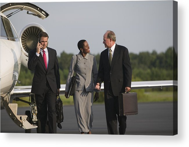 Three Quarter Length Acrylic Print featuring the photograph Men And Woman Talking Near Airplane by Comstock Images