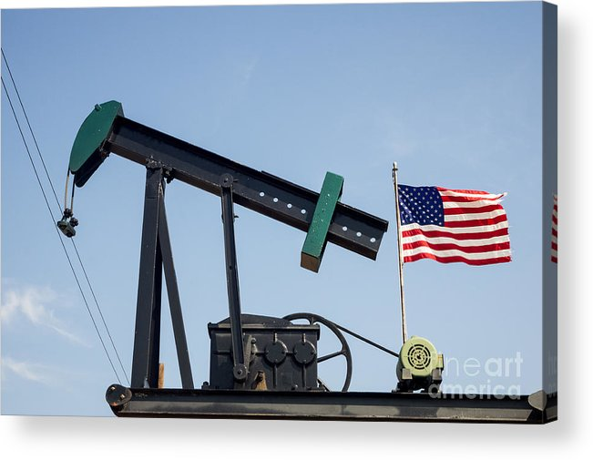 Oil Pump Acrylic Print featuring the photograph Oil Pump Jack And American Flag Waving by Imagery by Charly