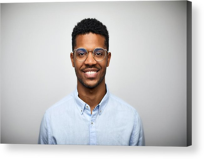 145abefbcea Young Men Acrylic Print featuring the photograph Portrait Of Smiling Young Man  Wearing Eyeglasses by Morsa