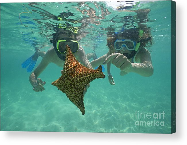 People Acrylic Print featuring the photograph Snorkellers Holding A Four Legs Starfish by Sami Sarkis