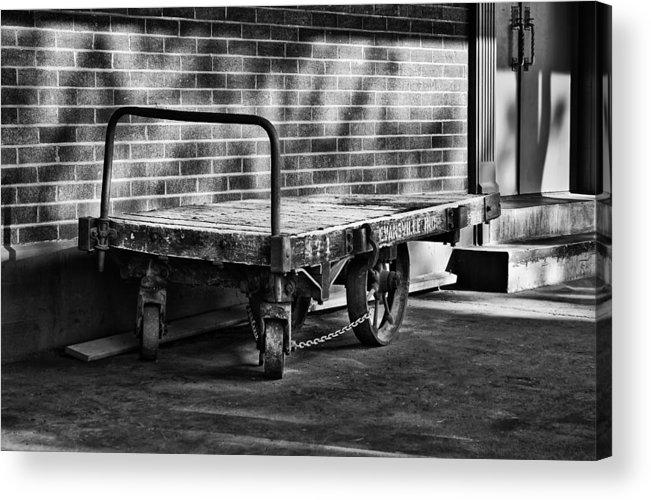 Train Depot Baggage Cart In B/w Acrylic Print featuring the photograph Train Depot Baggage Cart In B/w by Greg Jackson