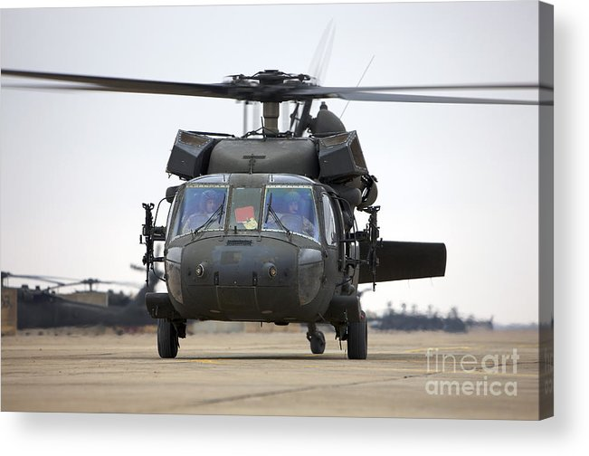 Aviation Acrylic Print featuring the photograph A Uh-60 Black Hawk Taxis by Terry Moore