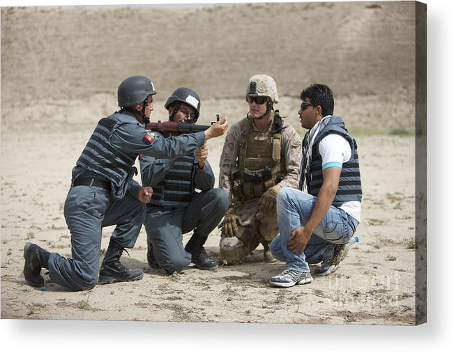 Afghanistan Acrylic Print featuring the photograph An Afghan Police Student Loads A Rpg-7 by Terry Moore