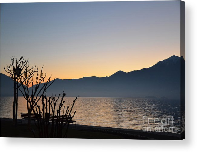 Blue Acrylic Print featuring the photograph Sunset Over An Alpine Lake by Mats Silvan