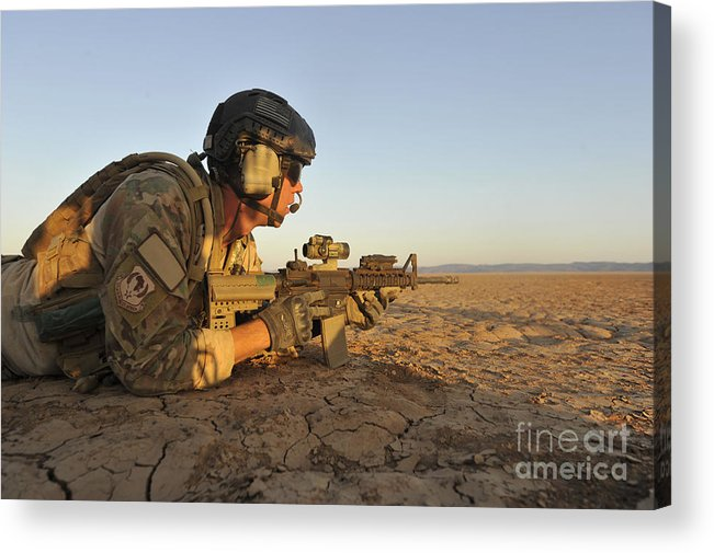 Holding Acrylic Print featuring the photograph A Combat Rescue Officer Provides by Stocktrek Images