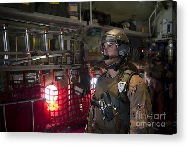 Us Air Force Acrylic Print featuring the photograph A Loadmaster Waits To Release A Load by Stocktrek Images