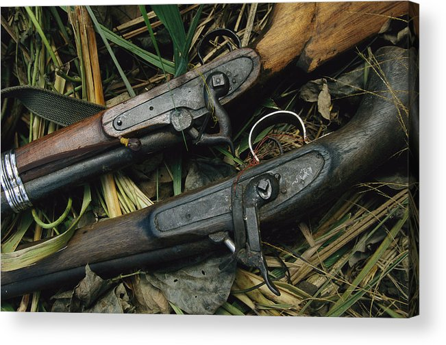 Asia Acrylic Print featuring the photograph A Pair Of Old Flint-type Rifles Lying by Steve Winter