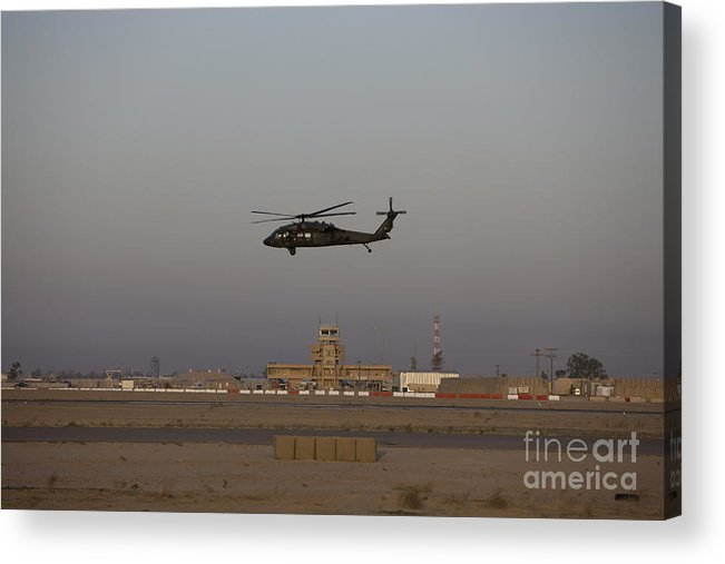 Aircraft Acrylic Print featuring the photograph A Uh-60 Blackhawk Helicopter Flies by Terry Moore