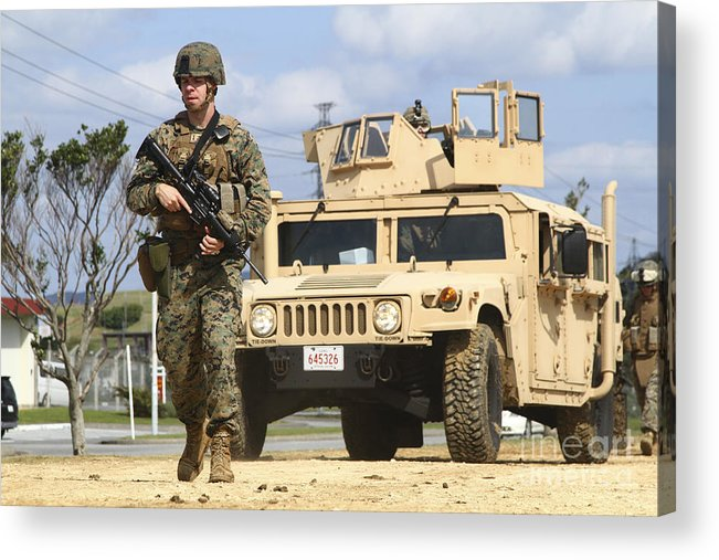 Motioning Acrylic Print featuring the photograph A U.s. Marine Guides A Humvee by Stocktrek Images