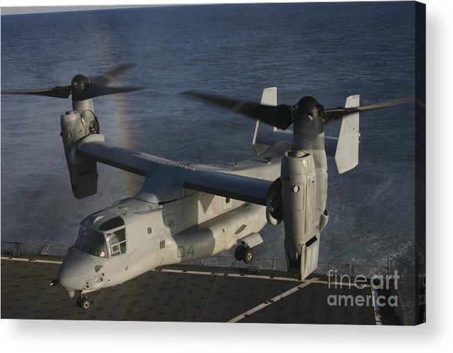 Rainbow Acrylic Print featuring the photograph An Mv-22 Osprey Prepares To Land Aboard by Stocktrek Images