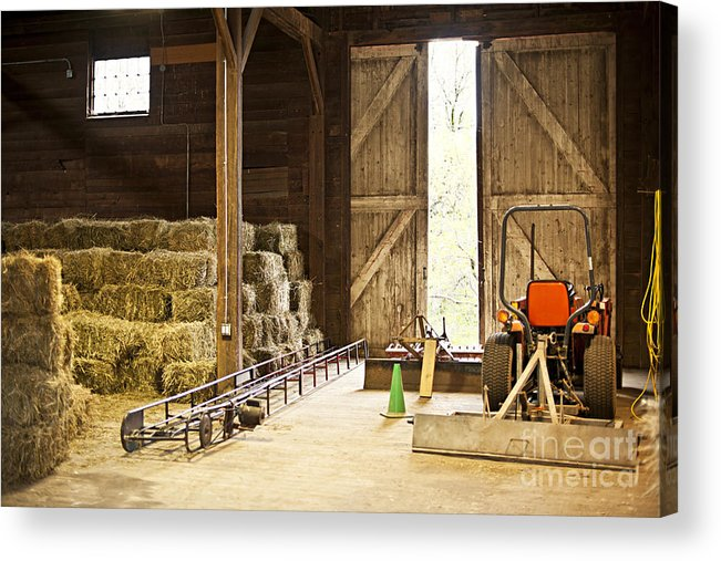 Barn Acrylic Print featuring the photograph Barn With Hay Bales And Farm Equipment by Elena Elisseeva