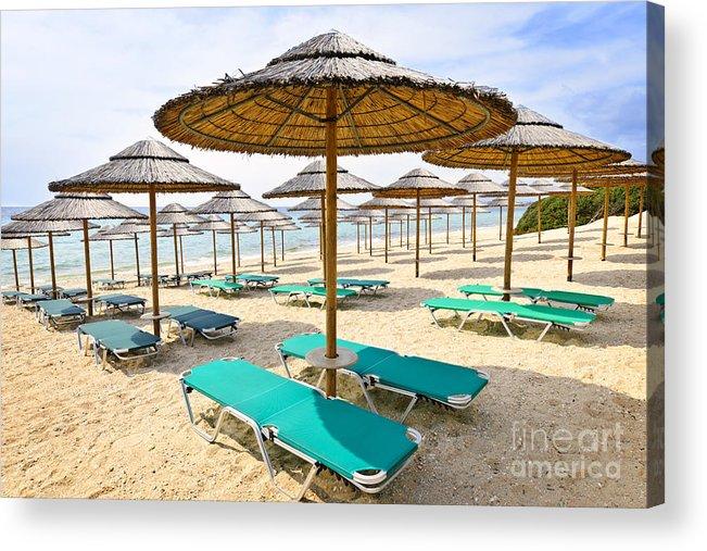 Beach Acrylic Print featuring the photograph Beach Umbrellas On Sandy Seashore by Elena Elisseeva