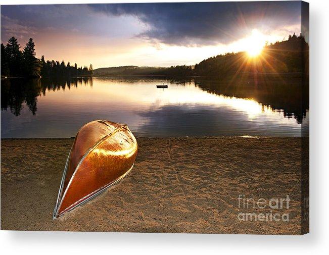 Canoe Acrylic Print featuring the photograph Lake Sunset With Canoe On Beach by Elena Elisseeva
