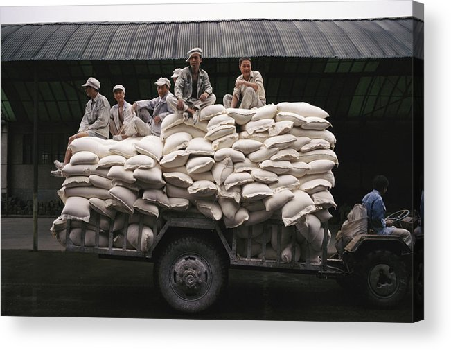 Medium Group Of People Acrylic Print featuring the photograph Men Sit On Bags Of Flour by Justin Guariglia
