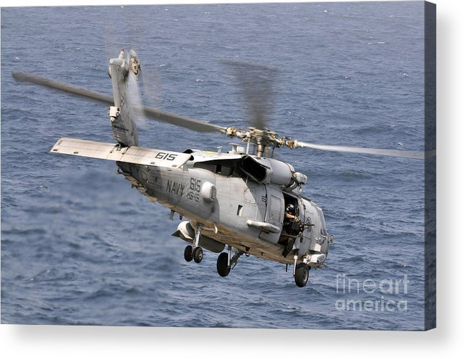 Warship Acrylic Print featuring the photograph N Hh-60h Sea Hawk Helicopter In Flight by Stocktrek Images