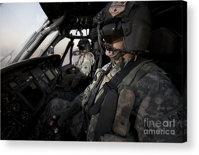 Cockpit Acrylic Print featuring the photograph Pilot In The Cockpit Of A Uh-60l by Terry Moore