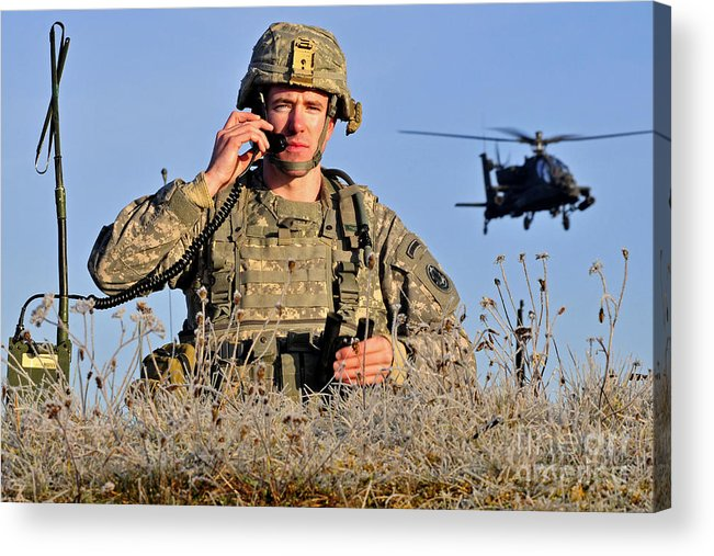 Grafenwoehr Acrylic Print featuring the photograph U.s. Army Captain Directs An Ah-64 by Stocktrek Images