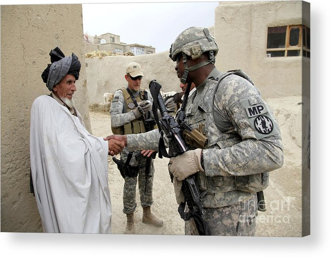 Middle East Acrylic Print featuring the photograph U.s. Army Soldier Shakes Hands With An by Stocktrek Images