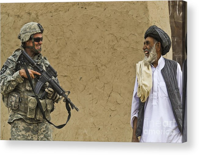 Afghan National Army Acrylic Print featuring the photograph U.s. Army Specialist Talks To An Afghan by Stocktrek Images