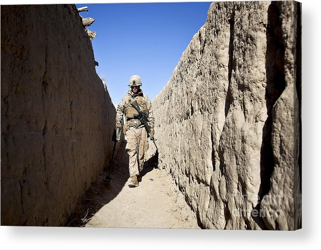 Afghanistan Acrylic Print featuring the photograph U.s. Marine Sweeps An Alleyway by Stocktrek Images