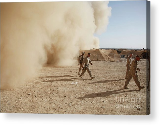 Debris Acrylic Print featuring the photograph U.s. Marines Walk Away From A Dust by Stocktrek Images