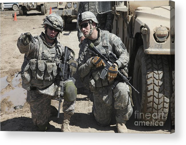 Military Acrylic Print featuring the photograph U.s. Soldiers Coordinate Security by Stocktrek Images